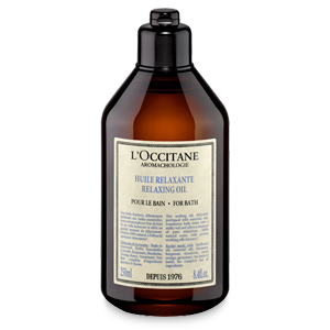 Bottle of Aromachologie Relaxing Oil for Bath, a natural bath oil that purifies skin for a soothing bath.
