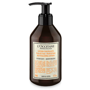 Bottle of Aromachologie Revitalizing Lotion for Hands & Body moisturizes & hydrates for softer skin.
