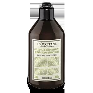 Bottle of Aromachologie Rebalancing Exfoliating Shower Gel exfoliates for softer skin.
