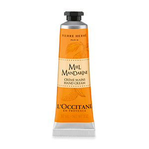 Tube of Honey Mandarin Hand Cream with shea butter and a honey orange scent that moisturizes and softens hands.