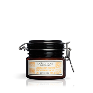 Jar of Aromachologie Revitalizing Body Scrub and skin exfoliant gently exfoliates for smoother skin.