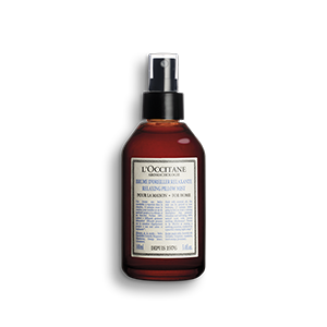 Bottle of Aromachologie Relaxing Pillow Mist and aromatherapy spray with essential oils.
