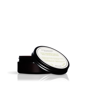 Jar of Aromachologie Rebalancing Black Soap, an olive oil soap that moisturizes and hydrates skin.