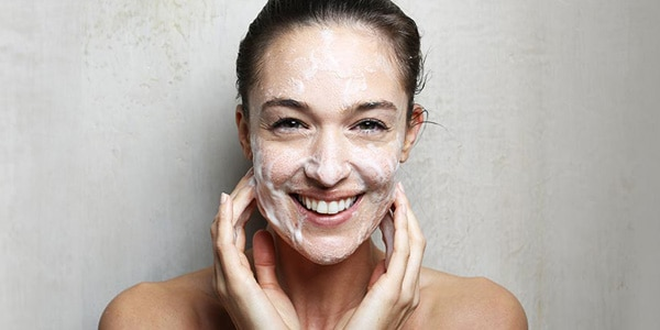 woman cleansing face - L'Occitane